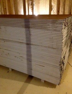 A huge stack of drywall sheets!